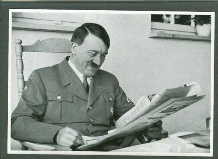 hitler-smiles-while-reading-newspaper