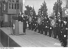 220px-Bundesarchiv_Bild_146-1999-007-36,_München,_Vortrag_von_Walther_Wüst (1)